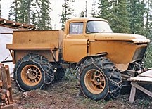 a truck with big wheels and chains