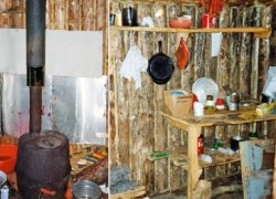 interior showing stove and supplies on shelf