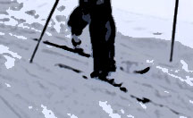 a man's feet on skiis