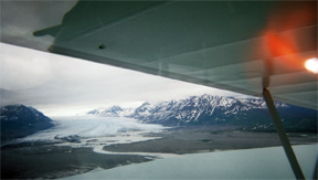 plane wing and view of glacier