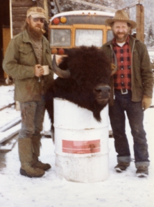 two men with buffalo head